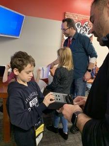 Child installing internet in BizTown's Sheetz