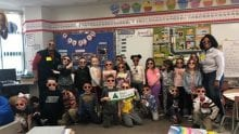 Comcast employees with group of Dormont Elementary School students