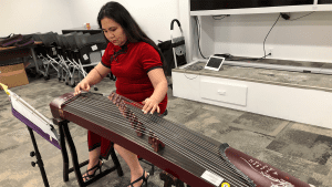 Comcast employee playing Chinese instrument