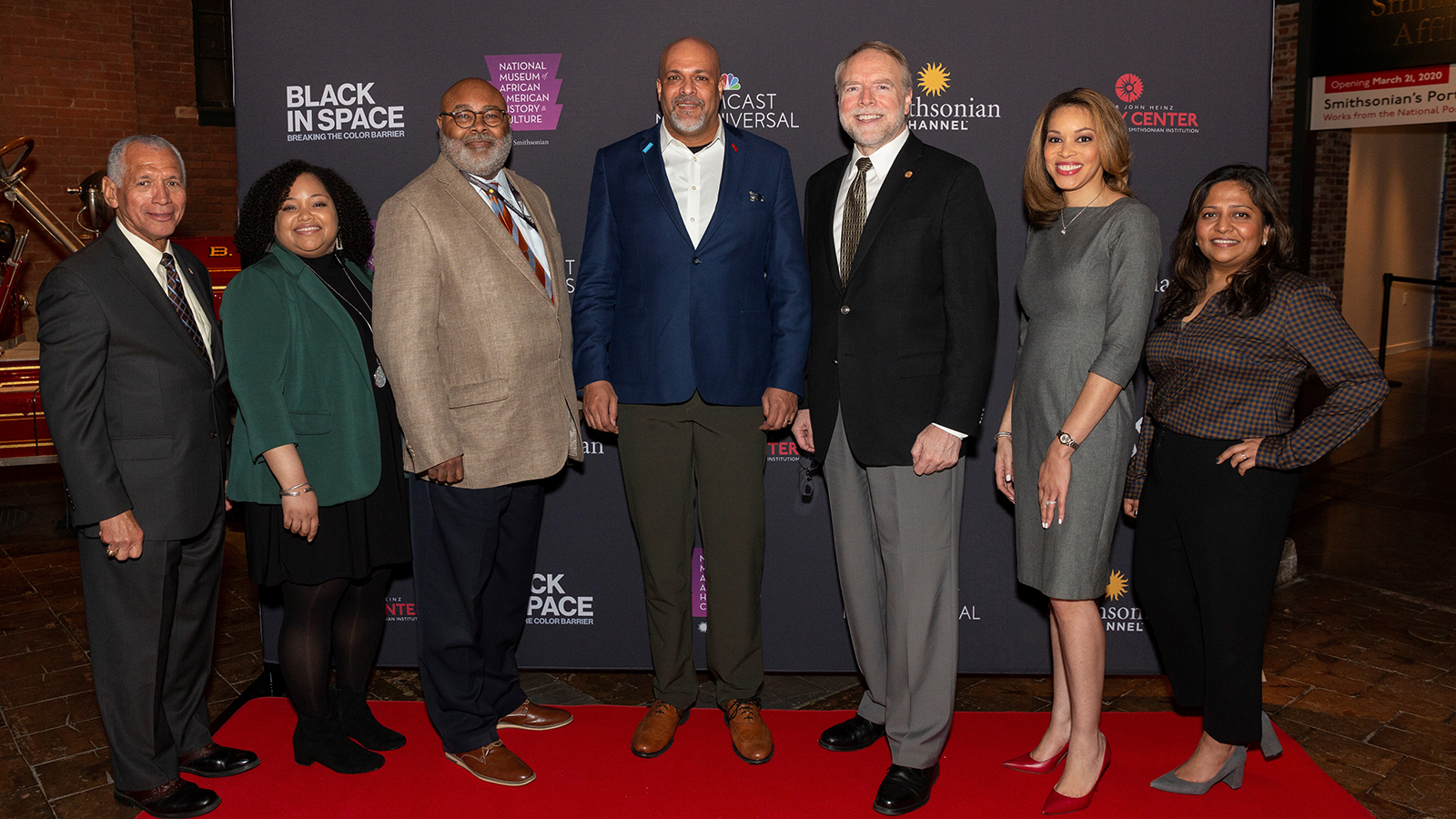 Senior leaders from Comcast on the red carpet at a private movie screening.