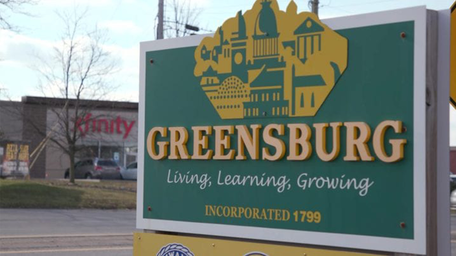 Greensburg sign in front of Xfinity Store.