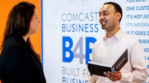 Comcast Business employee talking to business owner.