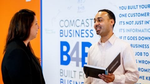 Comcast Business employee talking to business owner
