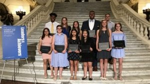 Students who won Comcast scholarships standing on steps in Pennsylvania Capitol