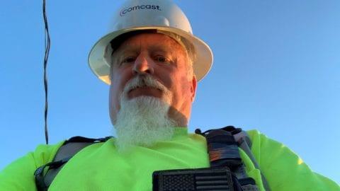 Comcast employee wearing hardhat