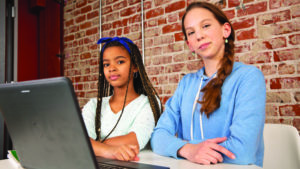 two girls looking at laptop