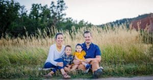 Radicic Family sitting in field