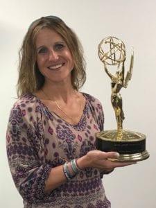 Comcast employee holding an Emmy Award