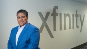 DeShane Hambrick standing in front of an Xfinity logo