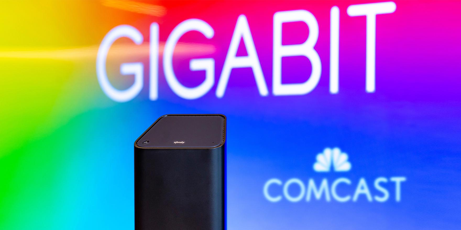 "Xfinity gateway with Comcast logo and ""Gigabit"" in background"