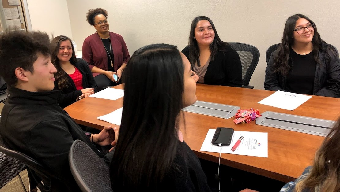 Students from Rio Grande High School sit around a conference table.