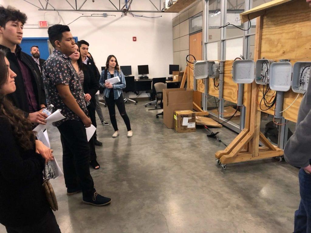 Students from Rio Grande High School watch a job shadowing presentation.